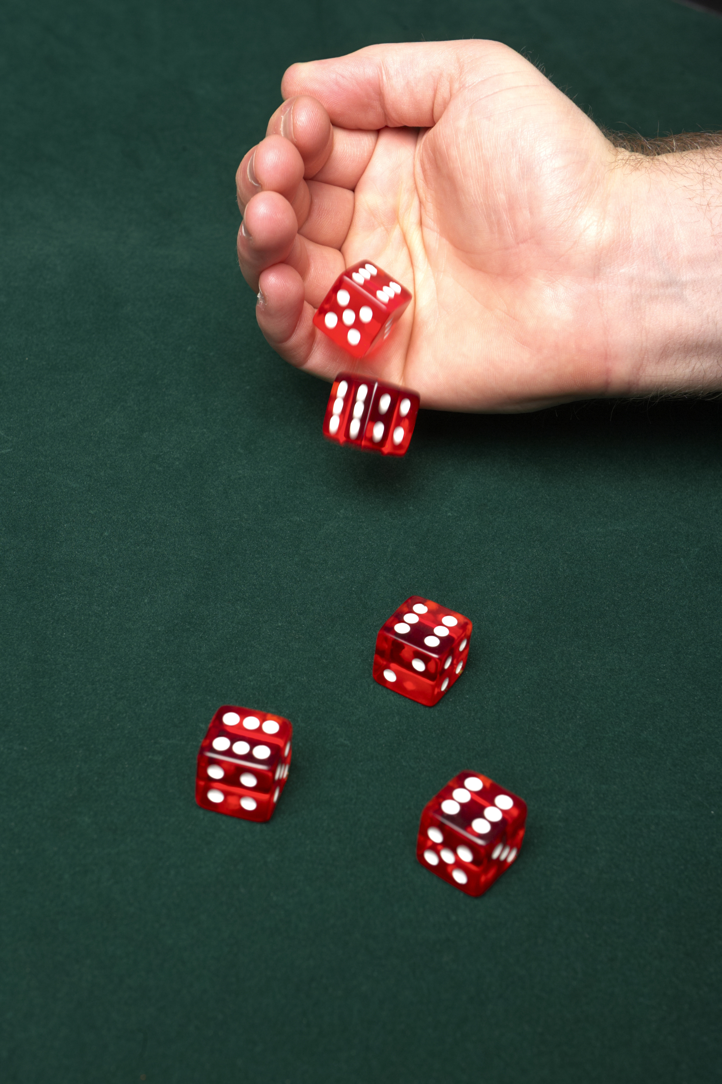 Man rolling 5 red dice