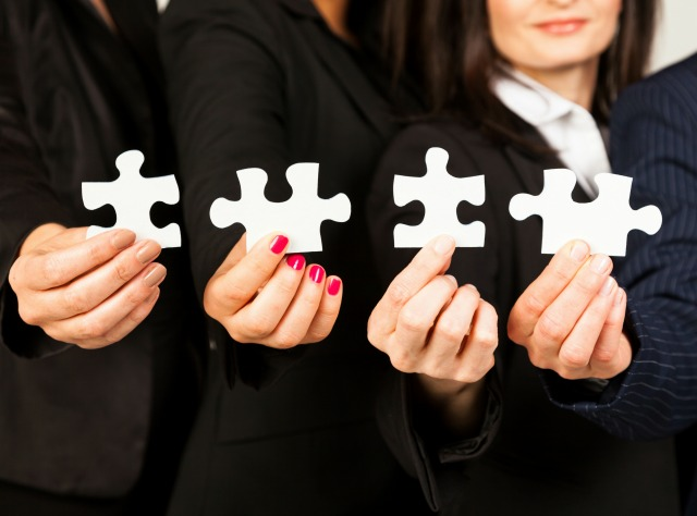 4-Business-women-holding-up-puzzle-pieces resized