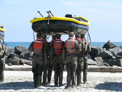 Navy seals carrying a raft