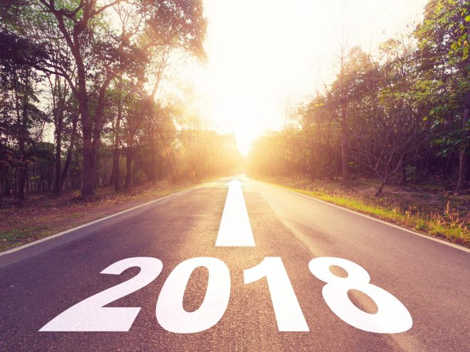 Empty asphalt road and New year 2018 goals concept.